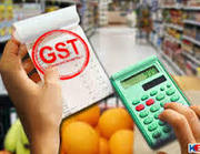 Define in Short what is GST @ +91-11-4306 0999